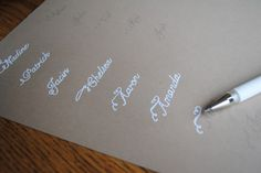 Faux calligraphy How to DIY: The trick is to use a very light colored font before printing, then just use your pen of choice and trace the letters. For my Thanksgiving place cards above, I chose a heavy kraft paper card stock with Nelly Script Flourish as my font, and I then used a white gel pen to trace.