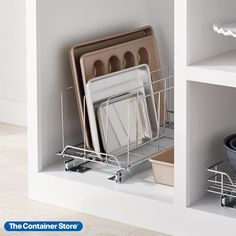 """Add professional-quality kitchen storage to cabinets with our Chrome Pull-out Bakeware Organizer. Engineered with commercial-quality steel, it's strong enough for tall cutting boards, pans, platters and trays, helping utilize the full height of your cabinet. Extra-durable dividers are spaced 3"""" apart to keep everything in place. Simply give a gentle tug to the front bar and this pull-out organizer provides instant access to contents. Industrial-grade bearings make for smooth operation every time Small Space Organization, Kitchen Organization, Kitchen Storage, Reach In Closet, Quality Kitchens, Container Store, Bakeware, Chrome Plating, Divider"""