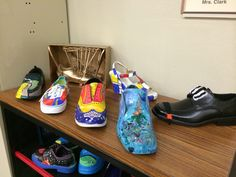 Shoes in the style of various artists.     5th and 6th graders studied 6 different artists. Final project was to choose one and paint a shoe in the style of the artist