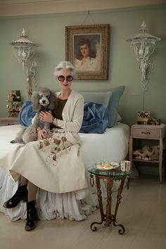 ADVANCED STYLE: Linda and Winky (I can never find sconces big enough to frame a large bay window. Looks like ol' Linda used outdoor lights and I love it!)