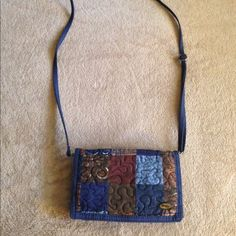 Donna Sharp Large wallet w/ strap.great condition Removable shoulder or crossbody adjustable strap Tri-fold snap-closure Exterior full-width zippered-pocket A store-everything wallet for larger bags or carry it solo with the crossbody strap! This remarkable tri-fold wallet even contains a checkbook section along with all the other compartment goodies. Donna Sharp Bags Wallets