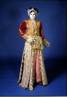 Woman's wedding outfit        Place of origin:        Turkey (made)      Date:        ca. 1900 (made)      Artist/Maker:        Unknown (production)      Materials and Techniques:        Woven silk, embroidered with metal thread and sequins      Credit Line:        Given by Miss Inés de Vaudry      Museum number:        T.96-1954
