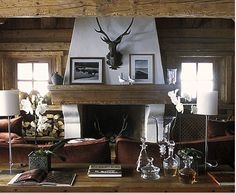 The perfect mountain house living room - love the wood beams and walls!