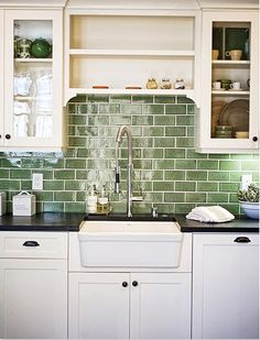 Green subway tile backsplash in white kitchen. Eco-friendly 62% recycled material tiles by Fireclay Tile.