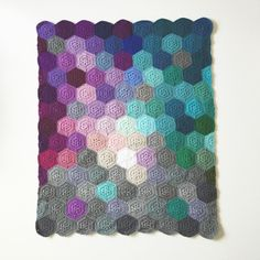 This blanket is 30 inches wide and 38 inches long, created with 100% easy care worsted weight acrylic yarn. The pattern is adapted from the Geometric Lace pattern found on etsy by BabyLoveBrand #op_crochet