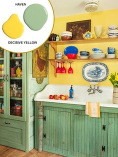 Open shelves replace upper cabinets on the sink wall, allowing light to flow from the adjacent window. Cupboards with push-latch doors were built in place under the sink. | Paint colors by @SherwinWilliams Haven and Decisive Yellow