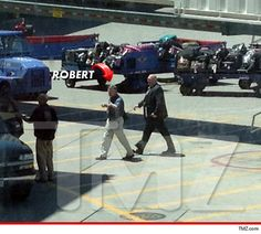 """Dr. Robert Holmes, James Holmes' father, just landed at the Denver International Airport, presumably to see his son who is in custody for the slaughter at the """"Dark Knight"""" premiere.    Robert Holmes flew from his home in San Diego and was mum when he got on the Southwest Airlines flight.    Robert Holmes was the first one off the plane and was escorted by cops into a police van."""