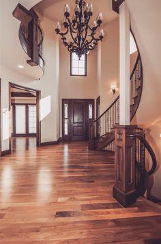 Entryway I love. Dark molding and floor no