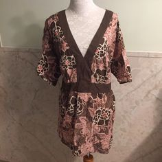 A.N.A. Pink & Brown Floral Tie Back Waist Top 1x This is a cute almost kimono wrap looking top by A.N.A. in a size 1x. It's made from a non-stretch cotton and is lightweight and perfect for summer. The waist ties behind the back, which is always a flattering look. There are slits on each side of the bottom hem. The sleeves are wide and short. a.n.a Tops Blouses