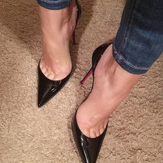 Black pumps, arches, and toe cleavage