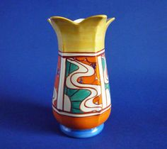 An early Fantasque orange Sunrise 361 shape petal vase Beautifully painted in orange green and blue with panels of stylised art deco sunrays banded
