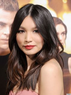 Gemma Chan - her brunette hair color pops against her milky complexion and matte red lips