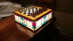 Stained Glass Chess Set. This is a one-of-a-kind handmade chess set. Game designer KnowNothing_JonSnoo received it as a birthday gift from his father, a stained glass artist.