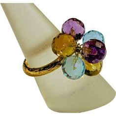 A 25.00ct Multistone Cluster Ring of Aquamarine, Citrine Amethyst and 14K Yellow Gold