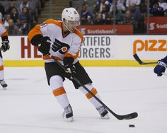 CrowdCam Hot Shot: Philadelphia Flyers forward Scott Laughton goes to get a loose puck against the Toronto Maple Leafs at the Air Canada Centre. Philadelphia defeated Toronto 3-2 in an overtime shoot out. Photo by John E. Sokolowski