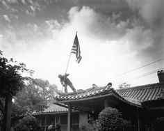 """ourforgottenwars: """"US Marine Pvt. Class Luther Leguire raises U. Flag at American consulate in Seoul, while fighting for the city raged around the compound. American Exceptionalism, Today In History, Korean War, Usmc, Marines, Vietnam War, Marine Corps, Luther, United States"""