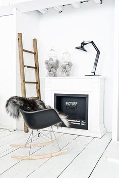 white, black and wood pine cones under cloche fireplace ladder