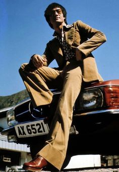 1970s Bruce Lee with his new Mercedes SL roadster