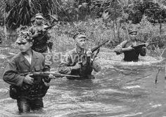 Patrol of Montagnard soldiers wading through jungle stream, led by US Special Forces Captain Vernon Gillespie during early years of Vietnam conflict. Get premium, high resolution news photos at Getty Images Photo Vietnam, Vietnam War Photos, American War, American History, Us Special Forces, Special Ops, Vietnam History, North Vietnam, United States Army