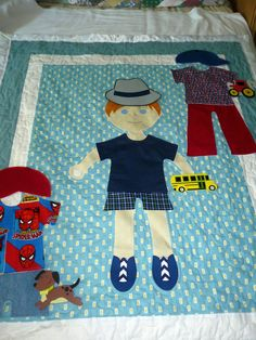 Dress Me Doll Quilts.  This is our first little boy quilt and was quickly snatched up by a teacher who will use it in her preschool classroom, along with one of our girl doll quilts.  These are available through custom order at my Etsy shop:  PiecesOfThePrairie.