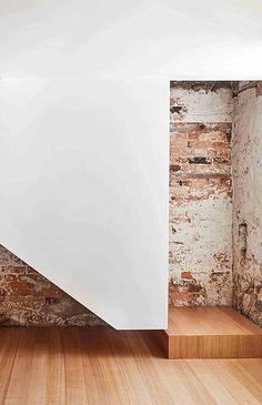 Exposed brick and minimal wall.