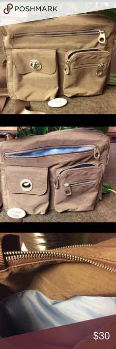 Popular Baggallini everything bag This Baggallini everything bag truly stands up to its' name!! I bought this originally for my mother in law but she liked another leather bag I bought her years ago and of course her bag looks immaculate.  This bag is. NWOT Baggallini Bags Crossbody Bags