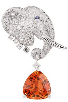Van Cleef and Arpels Les Voyages Extraordinaires collection 'Maximus' clip with Imperial Topaz.