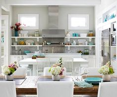 white kitchen with hits of wood and turquoise