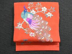 This is a Nagoya obi with peacock on 'sakura'(cherry blossom) tree motif, which is embroidered