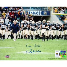 Charlie Weis Walking with Team on the Field 8x10 Photo w Go Irish Insc. - Web - Charlie Weis graduate of the University of Notre Dame made his name in the coaching world as the offensive coordinator of the New England Patriots. After helping them to win four different Super Bowls Weis then decided to return to his alma mater as the head football coach. He coached at Notre Dame from 2005 to 2009 before accepting the job as head offensive coordinator for the Kansas City Chiefs. Charlie Weis…