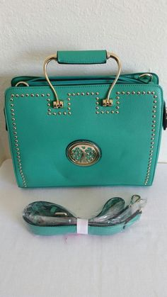 New (never used) - Turquoise handbag with shoulder strap. Divider on the inside. Brand new.
