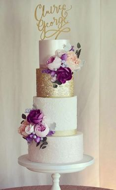 This Beautiful four tier blush wedding cake with gold accents and deep red flowers is perfect for autumn wedding - Choosing a wedding cake may seem like one of those minor details to take care of during your wedding planning Beautiful Wedding Cakes, Beautiful Cakes, Gold Wedding Cakes, Flower Wedding Cakes, Wedding Cake Purple, White And Gold Wedding Cake, Textured Wedding Cakes, 50th Wedding Anniversary Cakes, Purple And Gold Wedding
