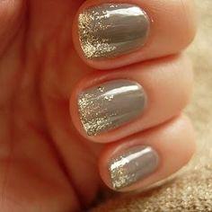 Gold flecks over dark gray polish