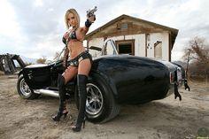 Jenny P sexy pics with a gun
