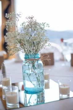 simple flowers (wrong color) in a jar with tie string