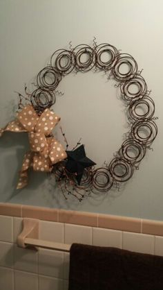 Mattress spring wreath with burlap bow and metal star.
