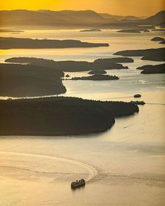 - Aerial view of a Washington State Ferry sailing through the San Juan Islands at sunset. The San Juan Islands are an archipelago in the Salish Sea in Northwestern Washington with great kayaking and whale watching opportunities. The Washington State...