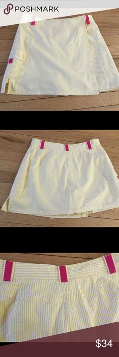 """Lilly Pulitzer searsucker skort skirt short set 4 Like new condition but interior zip is broken. Don't need it to wear it as there are buttons. Side Velcro pocket. Pink ribbon detail 15"""" long 28"""" waist 96% cotton/ 5% spandex Lilly Pulitzer Skirts Skirt Sets"""