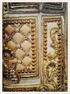 Embroidery detail backstage at the Balmain show c/o Vogue Paris