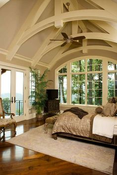 Love the floor and the neutral colors surrounding it with that balcony overlooking a great view!