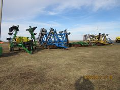 Farm equipment r-l:DMI crumbler,Landoll 850 Finisholl,John Deere 510,Landoll 7431,Farm King 1460