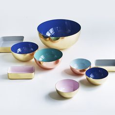 Metal enameled bowls, sizes small, medium, and large. Designed in Copenhagen by Louise Roe. Gorgeous for any occasion, filled or empty, and stunning when nested together.