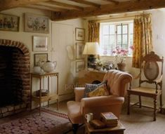A country cottage sitting room with beamed ceiling and brick fireplace, upholste. - A country cottage sitting room with beamed ceiling and brick fireplace, upholstered armchair, carved Style Cottage, English Cottage Style, English Country Decor, English House, French Cottage, English Cottages, French Country, Cottage Living Rooms, Cottage Homes