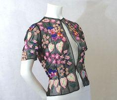 1930s French black silk sheer evening jacket with multi-color floral out of sparkling sequins. Photo Vintage Textiles.