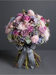 PIMLICO BOUQUET The Pimlico bouquet is a stunning mix of Autumnal flowers; mottled blue and green hydrangea combines perfectly with the pale pink dahlias, soft pink blooms and lilac roses. Picture showcases our large bouquet.