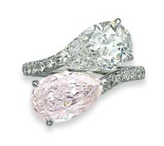 A COLOURED DIAMOND AND DIAMOND CROSSOVER RING. Centering upon a pear-shaped diamond, weighing approximately 3.02 carats and a fancy pink pear-shaped diamond, weighing approximately 3.01 carat, to the micro pavé-set diamond hoop, mounted in gold.
