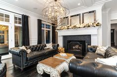 FAMILY ROOM // Could have a black chesterfield sofa made