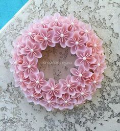 Origami Paper Flower Pink Wreath / wedding by kreationsbykiaThis wreath has 3 rows of origami flowers made from Vellum specialty scrapbook paper that are cut into then folded into a petal. The span of the flower is approxRead about Origami TutorialsS Paper Flower Wreaths, Pink Wreath, Paper Flowers Craft, Origami Flowers, Flower Crafts, Flower Paper, White Wreath, Origami Wreath, Paper Crafts Origami