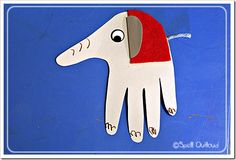 Elephant Handprint Craft - Trace hand onto grey cardstock. Cut out a half-circle out of cardstock and fold a flap to glue to the hand. Cut out a piece of red felt to go behind the ear. Tape a small piece of grey yarn for the tail. Add the details and you have a circus elephant