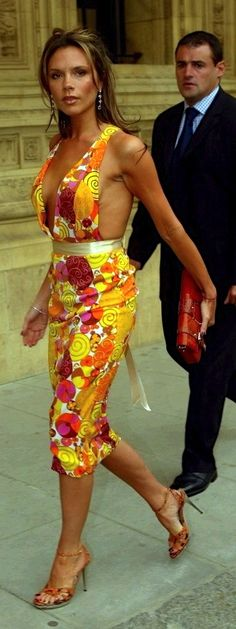 Victoria Beckham - love the dress and colour.... Would need more coverage for me...  :)